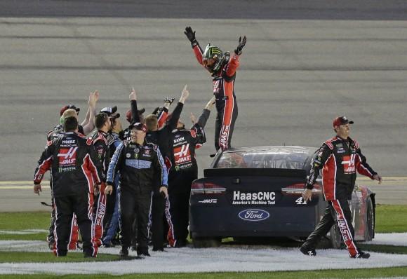 Kurt Busch, top, celebrates with crew members after winning the NASCAR Daytona 500 auto race at Daytona International Speedway in Daytona Beach, Fla. on Feb. 26, 2017. (AP Photo/Terry Renna)