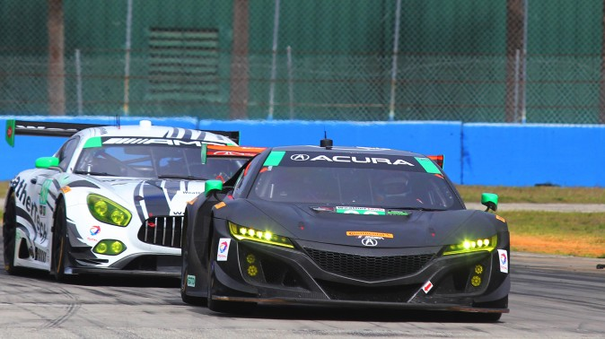 The #86 Acura NSX GT3 leads the #50 Riley-WeatherTech Mercedes AMG GT3 through Turn Ten. (Chris Jasurek/Epoch Times)