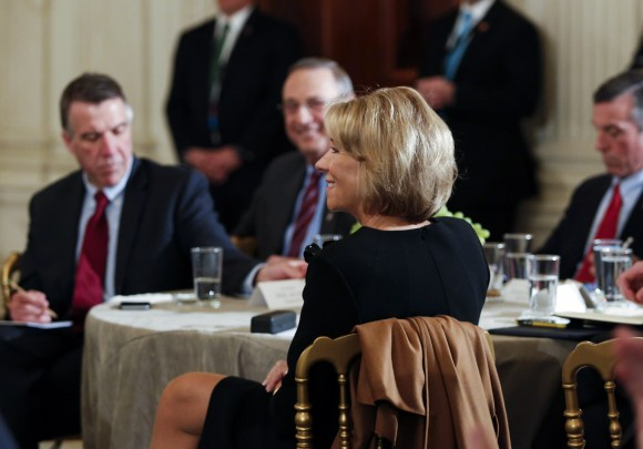 Secretary of Education Betsy DeVos listens to U.S. President Donald Trump at the National Governors Association meeting in the State Dining Room of the White House in Washington on Feb. 27, 2017. (Aude Guerrucci-Pool/Getty Images)