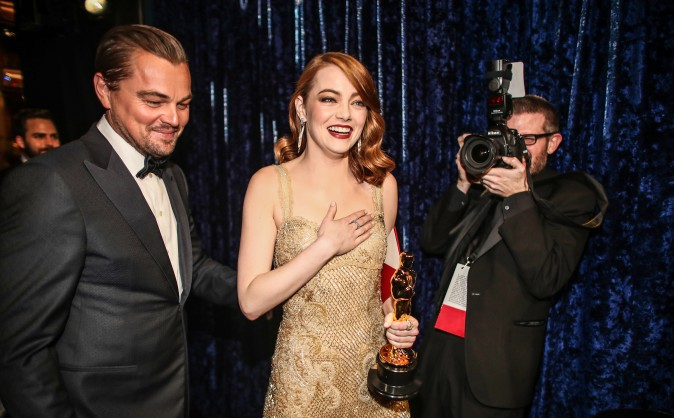 Leonardo DiCaprio walks out with Emma Stone who won Best Actress for 'La La Land' backstage during the 89th Annual Academy Awards in Hollywood, Calif., on Feb. 26. (Christopher Polk/Getty Images)