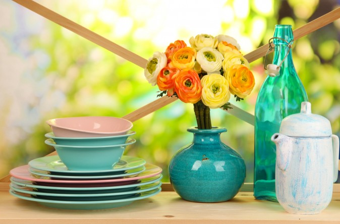 Colourful dishes, glassware, and flowers will brighten any kitchen. (Africa studio/Shutterstock)
