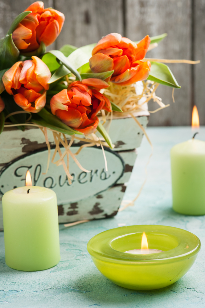 Fresh flowers and tea lights are an easy way to freshen a room and lend a hint of spring. (Irina Bort/Shutterstock)