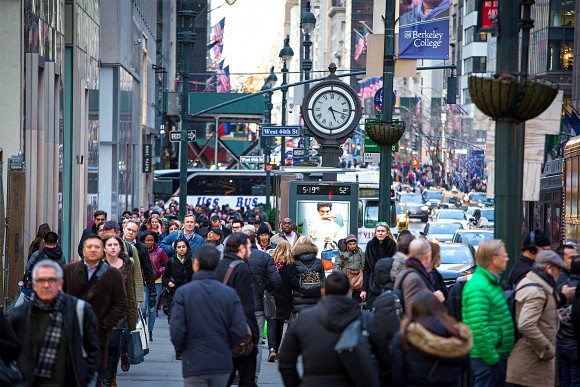 Pedestrians at Fifth Avenue at West 44th Street in New York City, Feb. 28. In October 2014, the New York City Council passed two pieces of legislation to protect illegal aliens, including criminals, from immigration law enforcement. (Samira Bouaou/Epoch Times)