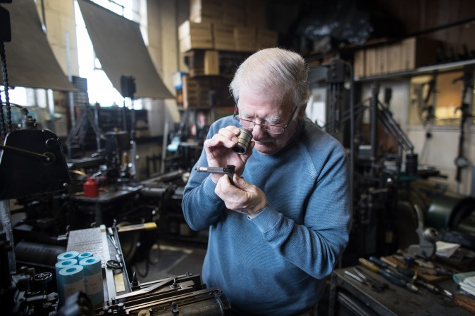 Printer Stan Lane checks the lettering produced by a composition caster at Gloucester Typesetting Services in Stonehouse, England, on Feb. 27, 2017. Stan Lane, who runs the last commercial Monotype business in Britain, started his career in 1954 as an apprentice aged 16. He is one of very few people still working in hot-metal lead type and is probably the last of the famous Monotype artisan print setters who still works for publishers and private customers. (Matt Cardy/Getty Images)