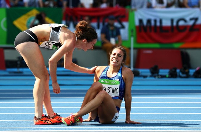 Nikki Hamblin of New Zealand shows good sportsmanship as she helps up Abbey D'Agostino of the United States after a collision during the Women's 5000m  at the Rio 2016 Olympic Games.  (Ian Walton/Getty Images)