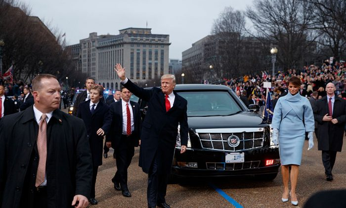 U.S. President Donald Trump waves to supporters as he walks the parade route with first lady Melania Trump and son Barron Trump after being sworn in at the 58th Presidential Inauguration in Washington, D.C. on Jan. 20, 2017. (Evan Vucci - Pool/Getty Images)