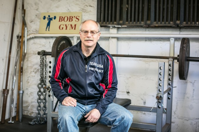 Robert Herbst, a 56-year-old attorney/businessman, owns 18 world and 32 national titles in powerlifting, at the gym inside his home in Larchmont, N.Y., on Feb. 24, 2017. (Benjamin Chasteen/Epoch Times)