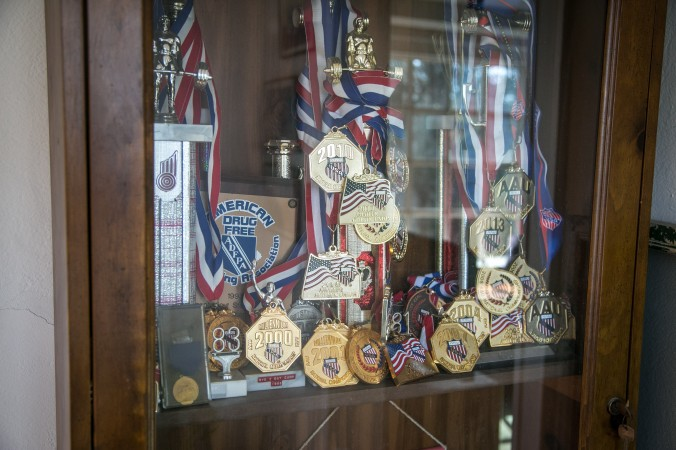 Some of Robert Herbst's American Drug Free Powerlifting Association National Championships medals. (Benjamin Chasteen/Epoch Times)