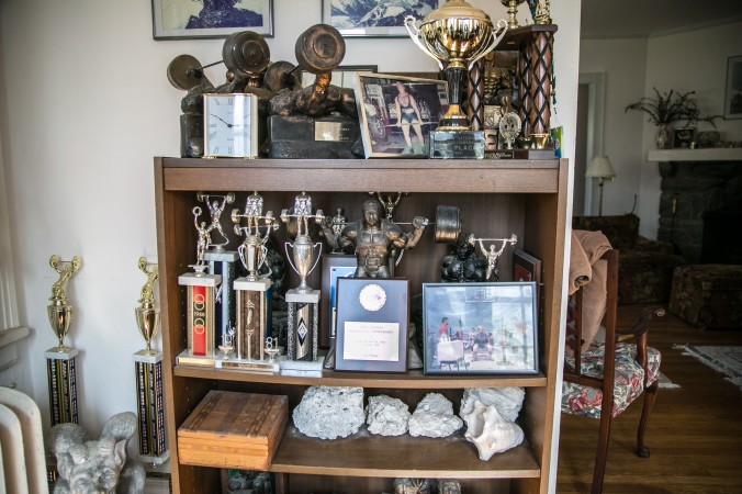 Metals and trophies powerlifter Robert Herbst has won throughout the years. (Benjamin Chasteen/Epoch Times)