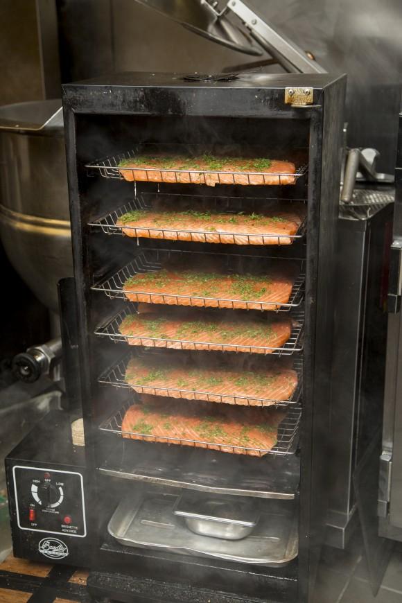Salmon gets smoked in a Bradley electric smoker at Halifax. (Samira Bouaou/Epoch Times)