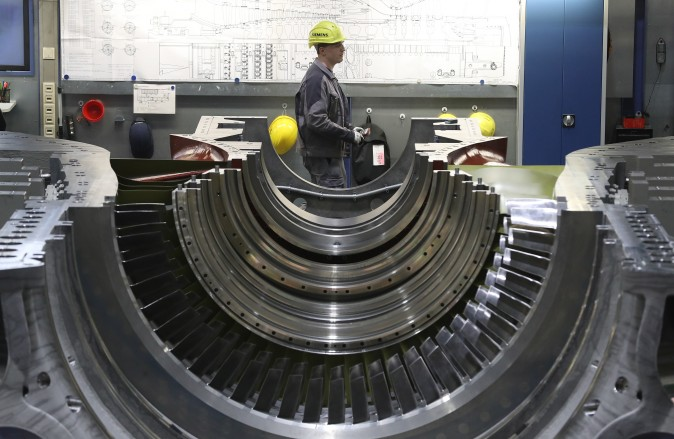 A worker walks past a partially-completed turbine at the Siemens gas turbine factory in Berlin, Germany, on March 2. Germany's number of unemployed fell by 15,000 in February compared to the month before and by 149,000 compared to one year ago. The unemployment rate is currently at 6.3%, which is close to the lowest it has been in 20 years. (Sean Gallup/Getty Images)