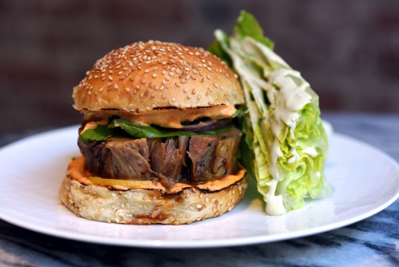 The confit lamb burger at Racines. (Michael Tulipan)