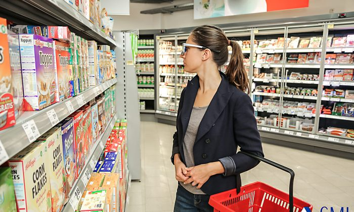 A shopper wearing eye tracking glasses peruses cereal options. Neuromarketers claim that through eye tracking, brain scans, and other tests, they can gain insight into people's subconscious reactions to marketing campaigns and products. (Photo courtesy SMI Eye Tracking)
