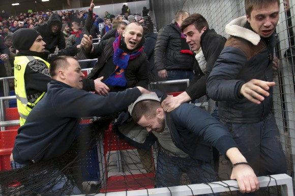 CSKA Moscow fans attack a Zenit fan (C) during the national championship soccer match between CSKA Moscow and Zenit in Moscow, Russia, on March 4, 2017. (AP Photo/Tikhon Danin)