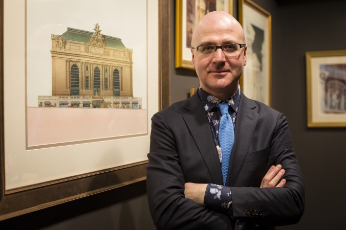 "Anton Glikin of Peter Pennoyer Architects at the ""Art of Architecture"" exhibit at Eleventh Street Arts gallery in Queens, New York, on March 2, 2017. (Samira Bouaou/Epoch Times)"