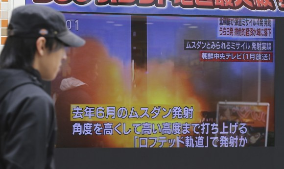A man walks past a screen showing a TV news on North Korea's missile firing, in Tokyo on March 6, 2017.  (AP Photo/Koji Sasahara)