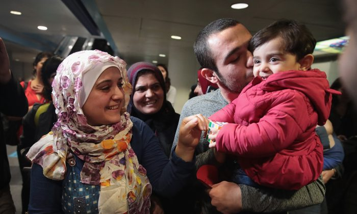 Syrian refugee Baraa Haj Khalaf (L) and her daughter Shams (R) are greeted by her brother Mohamad and mother Fattuom after arriving at O'Hare Airport in Chicago, Ill. on Feb. 7, 2017. (Scott Olson/Getty Images)