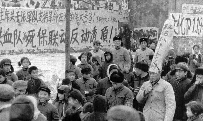 "A Chinese official is paraded through the streets of Beijing by Red Guards on Jan. 25, 1967. The words on his dunce cap accuses him of being a ""political pickpocket."" During Mao Zedong's reign (1949-1977), many Chinese citizens and officials were accused of political crimes, and labeled ""class enemies"" and ""counter-revolutionaries.""  (Associated Press)"