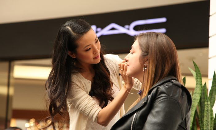 Youtuber and makeup artist Jen Chae demonstrates makeup techniques during at Westfield Valley Fair in Santa Clara, California on Mar. 4, 2017. (Kelly Sullivan/Getty Images)