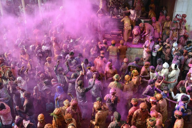 Indian people celebrate Holi, the spring festival of colors, during a traditional gathering in Nandgaon village, India, on March 7, 2017. (/AFP/Getty Images)