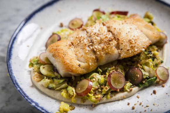 Hake paired with a garlicky almond purée. (Samira Bouaou/Epoch Times)
