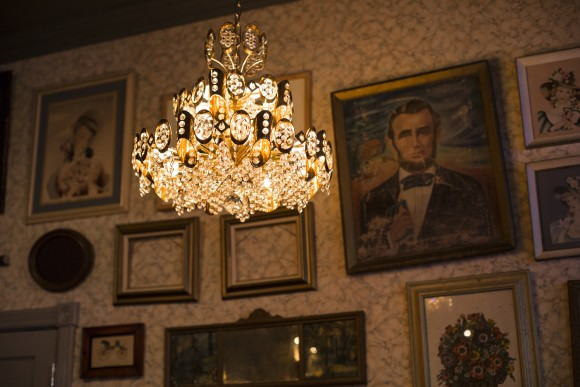 The walls are adorned with paintings and drawings collected by the owners from flea markets. (Samira Bouaou/Epoch Times)