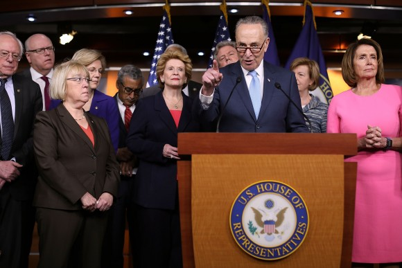 Senate Minority Leader Chuck Schumer (D-N.Y.) and fellow Democrats from both the House and Senate, including House Minority Leader Nancy Pelosi (D-Calif.) (R), at the U.S. Capitol on Jan. 4. (Chip Somodevilla/Getty Images)