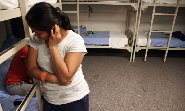 A Guatemalan woman in a federal detention facility for illegal immigrant mothers and children in Artesia, N.M., on Sept. 10, 2014. (AP Photo/Juan Carlos Llorca)