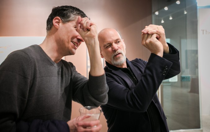 Founder of The Florence Academy of Art Daniel Graves (R) talks about a painting with artist Edward Minoff at the opening of the Consecrated Reality exhibit at The Florence Academy of Art-U.S. branch, on May 1, 2016. (Milene Fernandez/Epoch Times)