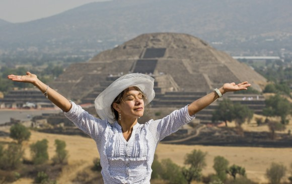 "A woman ""receives energy"" from the sun atop the Pyramid of the Sun at the archaeological site of Teotihuacan, Mexico, during the celebrations for the Spring Equinox on March 21, 2013. (Ronaldo Schemidt/AFP/Getty Images)"