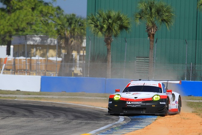 There is always one in the crowd who has to color outside the lines. Despite this off-track excursion, Porsche T Team driver Frederic Makowiecki turned the fastest GT Le Mans lap, 1:57.109 at 114.9 mph. (Chris Jasurek/Epoch Times)