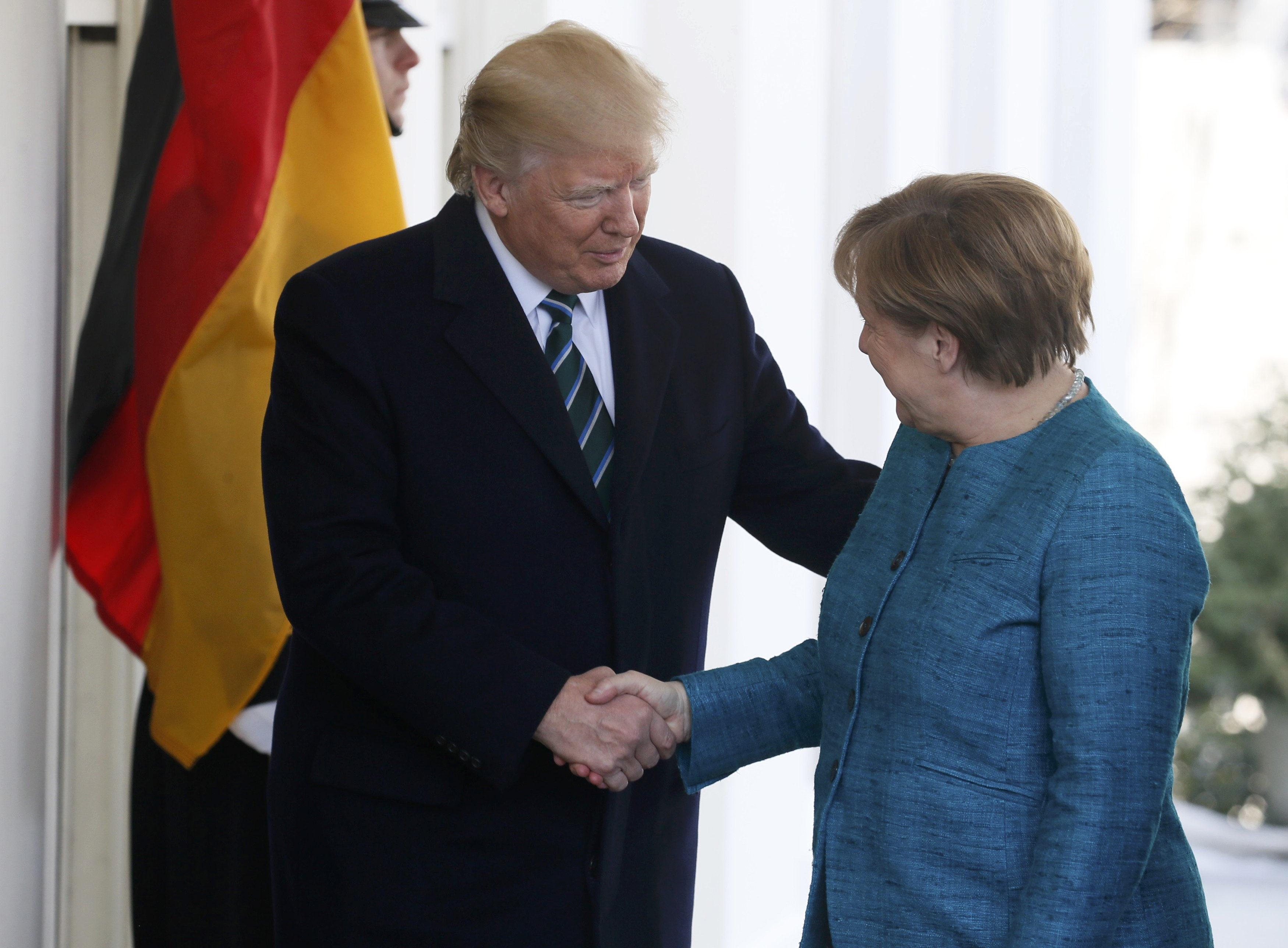 President Trump welcomes German Chancellor Angela Merkel at the White House.   (REUTERS/Jim Bourg)