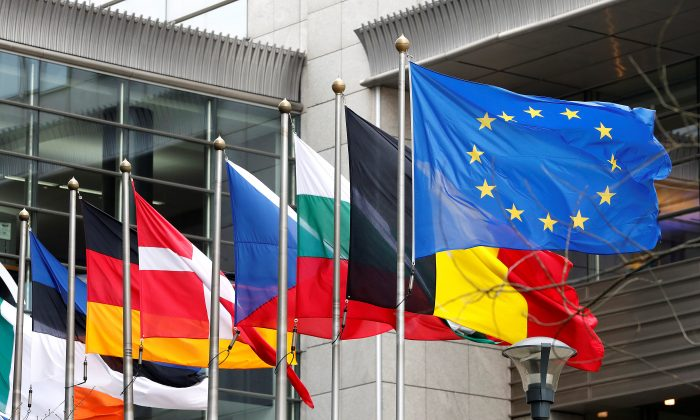 European and national flags fly outside the European Parliament in Brussels, Belgium on March 1, 2017. Although it has added many members since its founding in 1957, the EU has strayed from its original course. (REUTERS/Yves Herman)