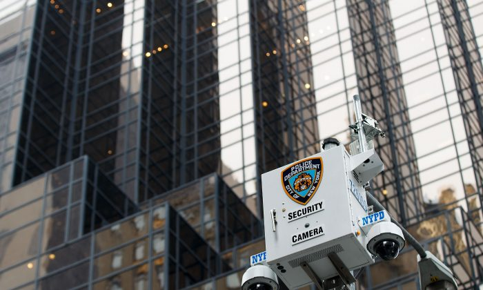 A New York City Police Department (NYPD) security camera hangs atop a light pole across the street from Trump Tower in New York City on March 7, 2017. (Drew Angerer/Getty Images)