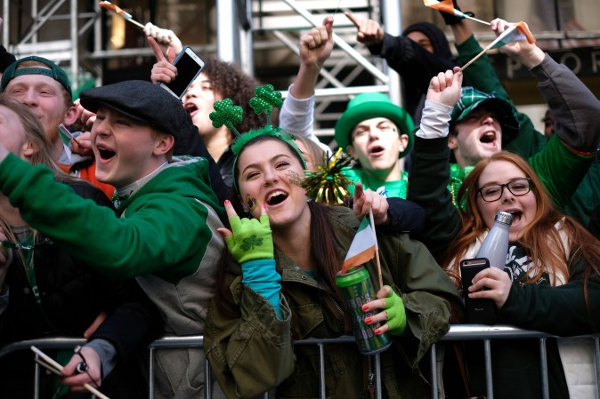People cheer as participants march on Fifth Avenue during the St. Patrick's Day parade in New York on March 17. (JEWEL SAMAD/AFP/Getty Images)