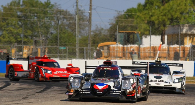 The Rebellion Leads the Mustang Sampling and Whelen Engineering Cadillacs at the start sof the Twelve Hours of Sebring. (Chris Jasurek/Epoch Times)