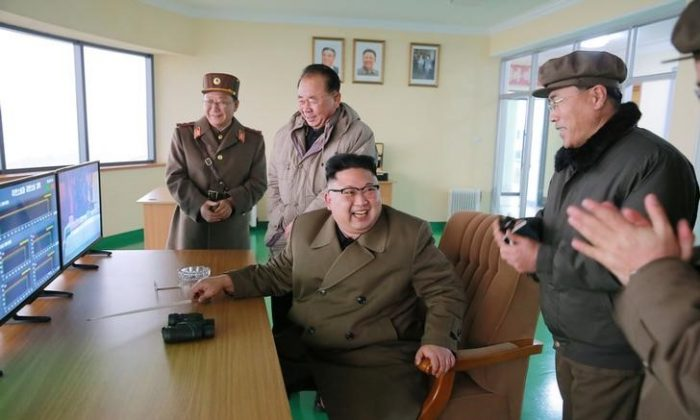 North Korean leader Kim Jong Un watched the ground jet test of a Korean-style high-thrust engine newly developed by the Academy of the National Defence Science in Pyongyang on March 19, 2017. (KCNA/via Reuters)