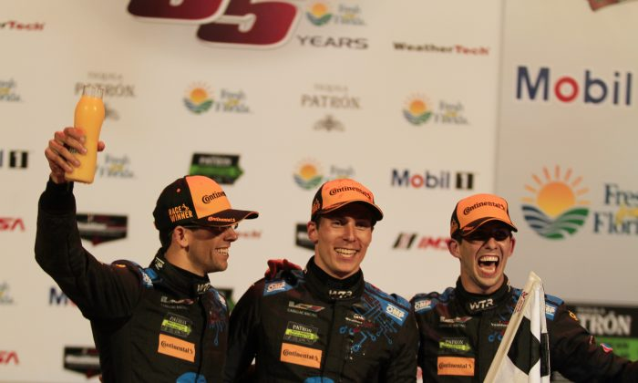 Jordan Taylor, Alex Lynne, and Ricky Taylor celebrate after winning the 2017 IMSA Twelve Hours of Sebring, March 18. (Chris Jaurek/Epoch Times)
