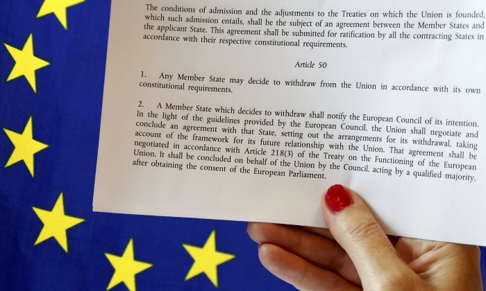 Article 50 of the EU's Lisbon Treaty that deals with the mechanism for departure is pictured near an EU flag following Britain's referendum results to leave the European Union, in this photo illustration taken in Brussels, Belgium on June 24, 2016. (REUTERS/Francois Lenoir/Illustration)
