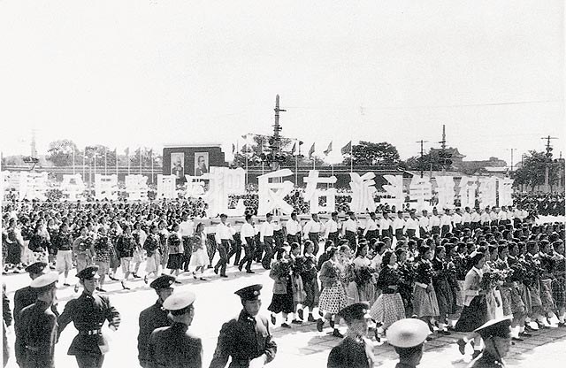 One of many 1950s Chinese parades showing support for the communist political movement. (Public Domain)