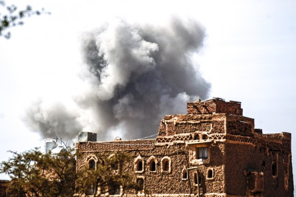 Smoke billows behind a building following a reported air strike by the Saudi-led coalition in the Yemeni capital Sanaa on Jan. 22, 2017. (MOHAMMED HUWAIS/AFP/Getty Images)