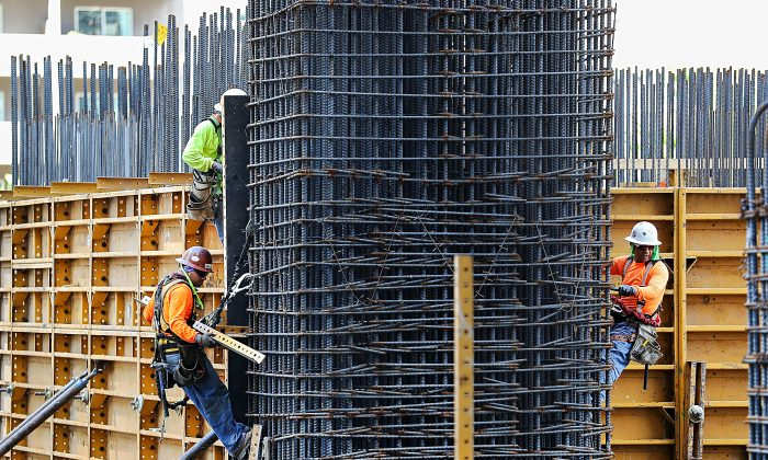 Construction workers in Miami on March 10. According to a new survey, the nonresidential construction sector expects business to grow, based on promises of big infrastructure spending. (Joe Raedle/Getty Images)