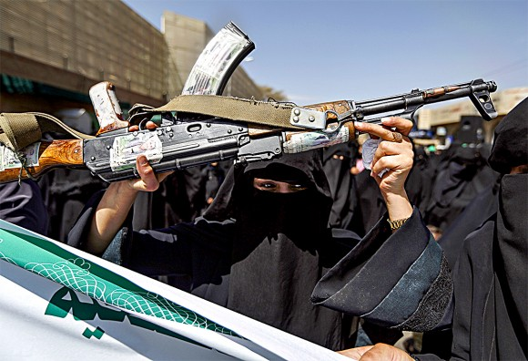 A Yemeni woman brandishes a rifle during a protest in front of the Saudi Embassy in Sanaa on March 18.