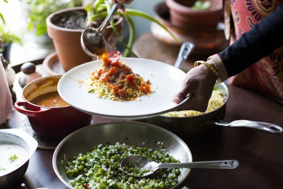 Agrawal serves lemon-peanut rice with rasam tomato and lentil soup. (Samira Bouaou/Epoch Times)