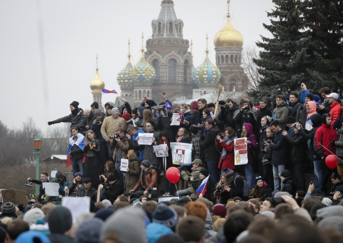 Protesters gather at Marsivo Field in St.Petersburg, Russia, on March 26. Thousands of people crowded in St.Petersburg on Sunday for an unsanctioned protest against the Russian government, the biggest gathering in a wave of nationwide protests that were the most extensive show of defiance in years. (AP Photo/Dmitri Lovetsky)
