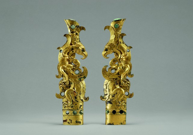 Pair of finials in the shape of mythical beasts, Qin Dynasty (221–206 B.C.). Gilt bronze inlaid with glass, Xi'an Museum. (The Metropolitan Museum of Art)