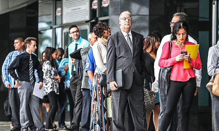 People stand in line as they wait to get into a job fair in Sunrise, Fla., on Nov. 15, 2016. (Joe Raedle/Getty Images)