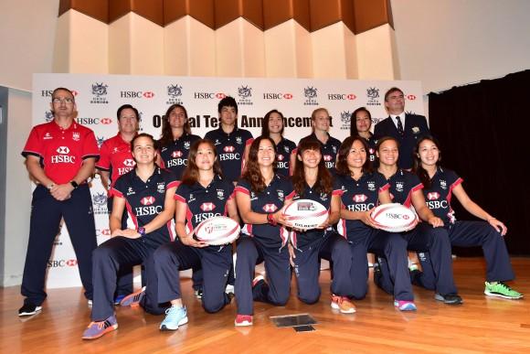 Hong Kong Women's squad together with (L) Paul John, Men's coach; Women's Head coach and on far right Robbie McRobbie Deputy CEO of the HKRU: Team Back Row (L-R): Amelie Seure, Aggie Poon Pak-yan, Sham Wai-sum, Adrienne Garvey, Christy Ka-chi, Robbie McRobbie Deputy CEO of the HKRU. Front Row : Colleen Tjosvold, Yuen Lok-yee, Candy Cheng Tsz-ting, Chong Ka-yan, Nam Ka-man, Natasha Olson-Thorne, Ivy Kwong Sau-yan. (Bill Cox/Epoch Times)