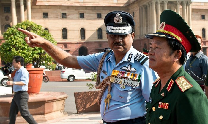 Indian Air Force (IAF) Chief and Chairman of the Indian Chiefs of Staff Committee N.A.K. Browne (L) gestures while talking with Chief of the General Staff of the Vietnam Peoples Army Senior Lieutenant General Do Ba Ty (R) in New Delhi on September 24, 2013. A high-ranking military delegation, led by Chief of the General Staff of the Vietnam Peoples Army Senior Lieutenant General Do Ba Ty, arrived on a official visit to India at the invitation of Air Chief Marshal N.A.K. Browne, Chairman of the Indian Chiefs of Staff Committee.The five day visit, ending on September 27, aims to further strengthen the friendly relations and cooperation between the two nations people and armies. AFP PHOTO/ Prakash SINGH        (Photo credit should read PRAKASH SINGH/AFP/Getty Images)