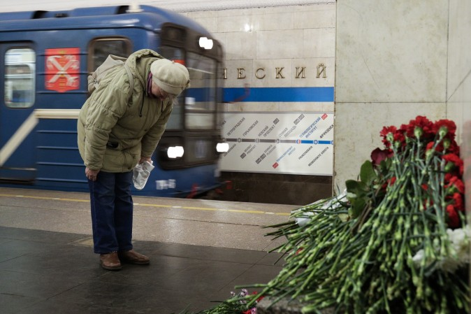 A woman pays her respects at a makeshift memorial at Tekhnologichesky Institute subway station in St. Petersburg, Russia, on April 4, the day after a bomb blew up a subway car, killing at least 14 people. (AP Photo/Dmitri Lovetsky)